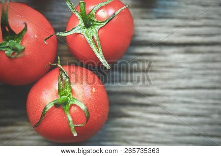 Cherry Tomatoes On Wood. Cherry Tomatoes On Vine With Water Drops. Red Color Vegetables Photographya