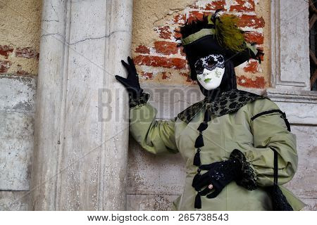Carnival Green-black Mask And Costume At The Traditional Festival In Venice, Italy