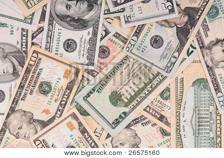 Money background of $5-$100 banknotes