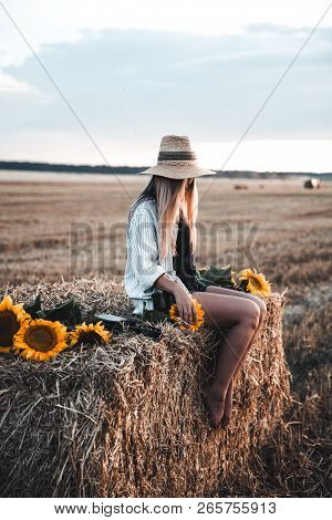 Young Beautiful Woman On Field In Summer A