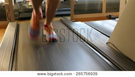 Running Shoes Training. Woman Feet In Colorful Shoes Running On Treadmill Machine Indoor. Fitness Ce