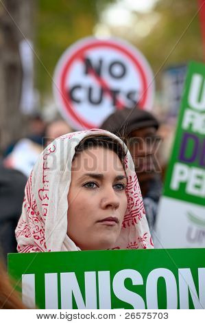 London, England, Uk - November 30 2011: Female Protester, With Unison Trades Union Sign, Listening T