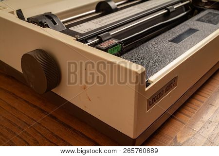 Legend 1980s Dot Matrix Printer. Kitchen Wood Table Inside A Private Apartment. Italy Europe