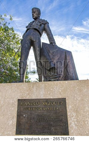 Seville, Spain - December 6, 2017: Monument To The Famous Spanish Bullfighter Manolo Vazquez (manuel