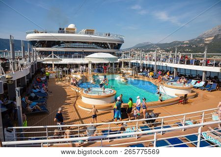 Mediterranean Sea, Montenegro - 15.10.2018: Tourists Relax At The Swimming Pool At Cruise Liner Norw