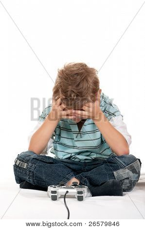 Little child playing a video game on white background