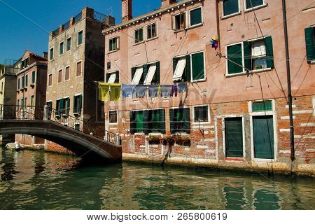 View Of Houses And Canal Street With Bridge In The Old Town Venice Italy