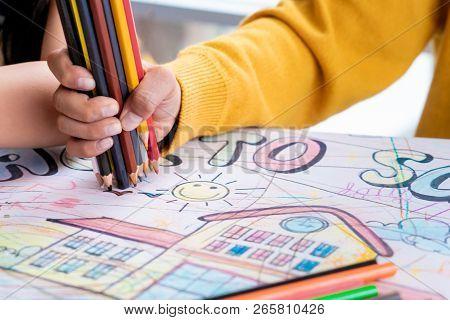 Boy Hand Is Drawing In Kindergarten Art Classroom