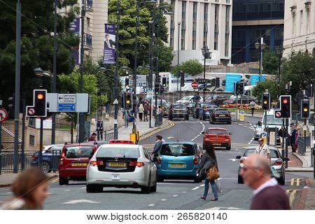 Leeds, Uk - July 12, 2016: People Drive In Downtown Leeds, Uk. United Kingdom Has 519 Vehicles Per 1
