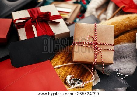 Gift Box With Empty Black Tag, Credit Cards, Money, Wallet, Bags, Clothes, Jewelry On Rustic Wood. S