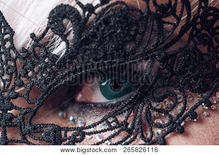 A little glam and style. Heterosexual man with male makeup. Glamorous trashy look. Fetish fashion. Transgender man wear lace mask. BDSM fashion accessory. poster