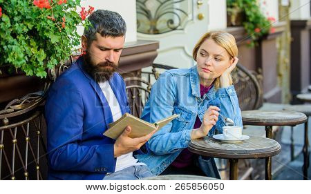Man With Beard And Blonde Woman On Romantic Date. Common Interests. Couple In Love Sit Cafe Terrace.