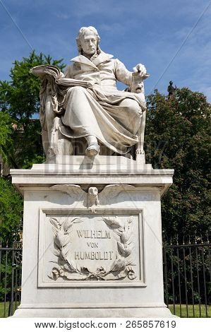 Wilhelm von Humboldt statue outside Humboldt University from 1883 by Martin Paul Otto, Berlin, Germany, sunny day poster
