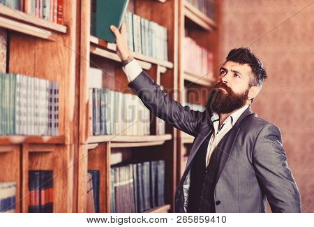 Vintage Style And Fashion. Bearded Man In Expensive Suit In His Cabinet. Professor Stands In Big Lib