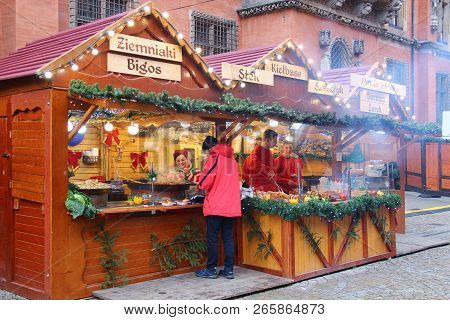 Wroclaw, Poland - December 8, 2017: Food Stalls With Typical Polish Cuisine At Winter Christmas Mark