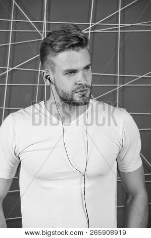 Man Unshaven Bearded Stylish Hairstyle Listen Music Or Motivating Speech Earphones. Listen Music Rad