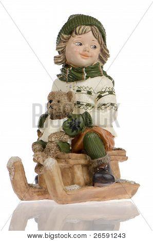 Miniature Of Child On Sleigh