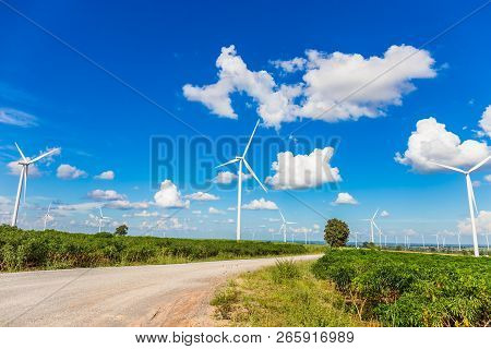 Wind Turbine Farm In Beautiful Nature With Blue Sky Blackground, Generating Electricity In Nakorn Ra