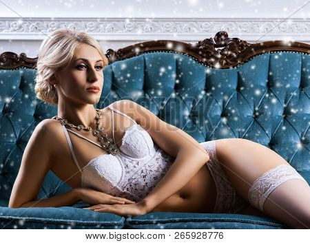 Young And Sexy Woman In Bridal Lingerie. Lady In Beautiful Underwear Posing In Vintage Interior.