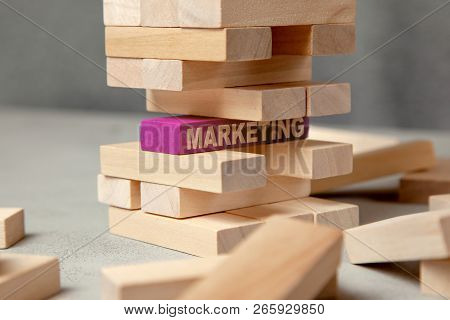 Digital Marketing Strategy Is The Basis Of Business. Tower Of Wooden Blocks And In The Foundation Of