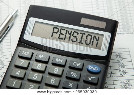 Calculator With The Inscription On The Pension Display On The Paper Tables. Pension Calculation.