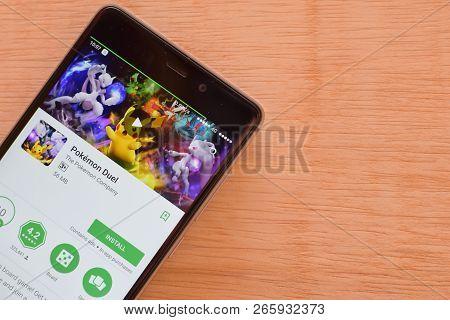 Bekasi, West Java, Indonesia. October 30, 2018 : Pokemon Duel Dev Application On Smartphone Screen.