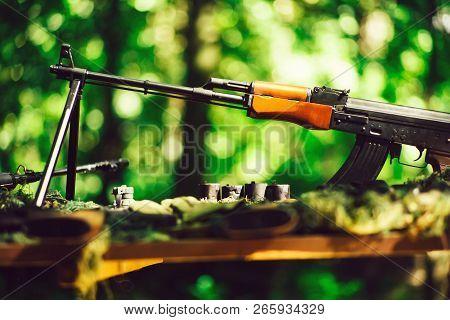 War guns arsenal modern military assault rifles shotgun weapon arms outdoors on natural background poster