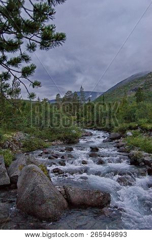 Fast Mountain River. Waterfall. Headwaters Mountain River. The Tumnin River Is The Largest River On