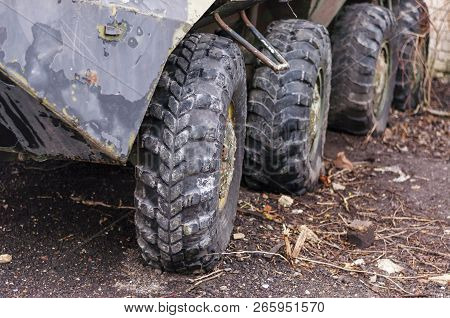 Big Rubber Wheels Row On Old Armored Personnel Carrier
