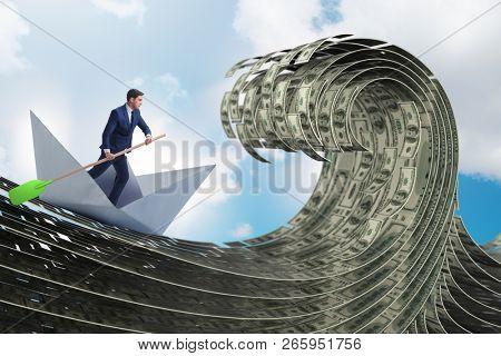 Businessman riding paper boat in dollar sea