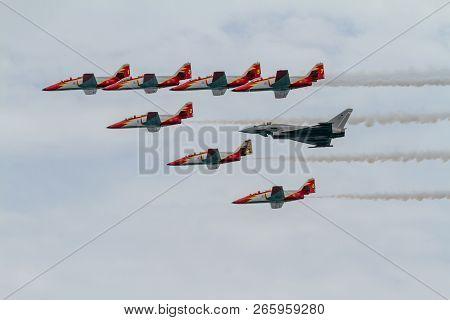 Torre Del Mar, Malaga, Spain-jul 31: Aircraft Casa C-101 Of The Patrulla Aguila And Eurofighter Typh