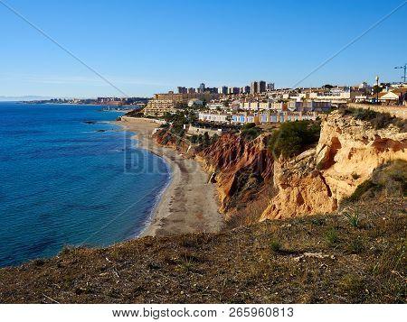 Popular summer travel destination the beach front of beautiful Campoamor Orihuela Coast Spain poster