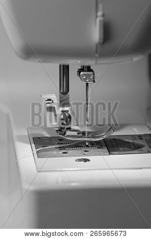 Closeup Of The Electric Household Sewing Machine And Item Of Clothing