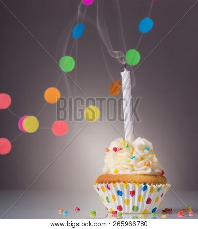 Festive Birthday Cupcake With A Candle On A Bright Background