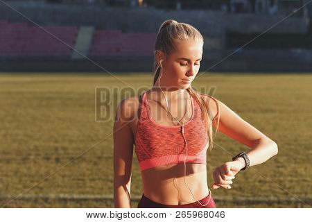 Portrait Of Athletic Attractive Blonde Long Haired Woman In Sportswear Standing At The Football Stad