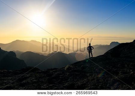 Woman Hiking Silhouette In Mountains, Sunset And Ocean. Female Hiker Looking At Beautiful Inspiring