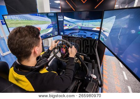 Moscow, Russia - October 27 2018. Simulation Of Race Car Video Player Game With Big Screen Monitors