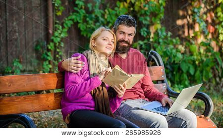 Couple Spend Leisure Reading. Information Source Concept. Couple With Book And Laptop Search Informa