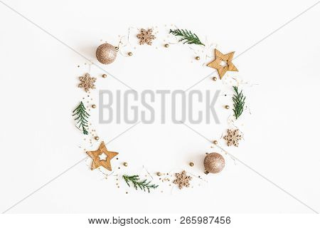 Christmas Composition. Christmas Wreath Made Of Golden Decorations, Fir Tree Branches On White Backg