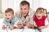 Happy family - father and children playing a video game poster