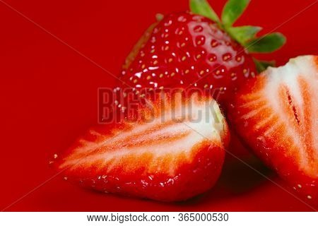 Strawberry Background. Side View Of Strawberry Slices On A Red Surface. Texture Of Strawberry Berrie