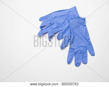 Pair Of Blue Disposable Non-sterile Gloves On A White Background. Image Has Copy Space And Shallow D