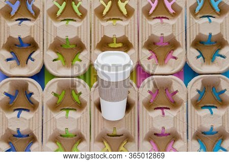 Reuse Coffee Tumbler With Recycle Paper Sleeve Put On Recycle Paper Trays With Colorful Background.