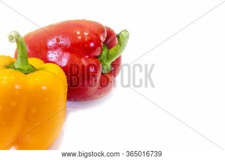 Paprika. Red Pepper. Pepper On White Isolated. Sweet Red Pepper. Full Depth Of Field. Drops Of Dew A