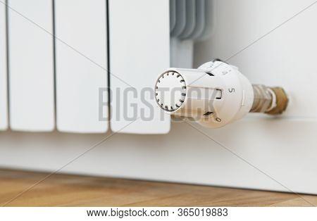 Temperature Regulator, Thermostatic Radiator.white Radiator In An Apartment.