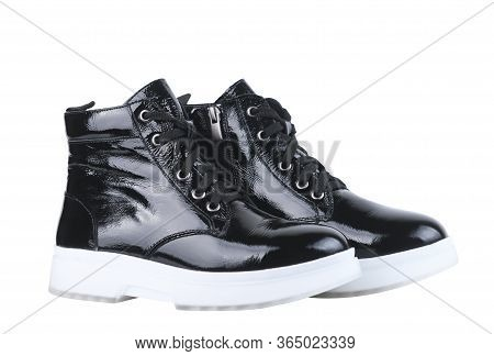 Female Boot From Black Patent Leather On A White Sole, On A White Background.elegant Leather Shoes F