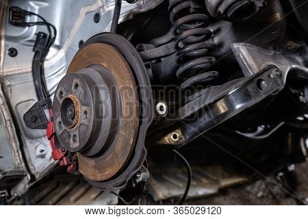 Close-up Of A Car Hub, Brake Caliper, Brake Pads, Brake Disc, Wheel Bearing Prepared For Repair. Wor