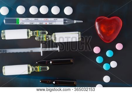 Glass Thermometer, For Measuring Body Temperature, Against A Background Of Blackout, Close-up