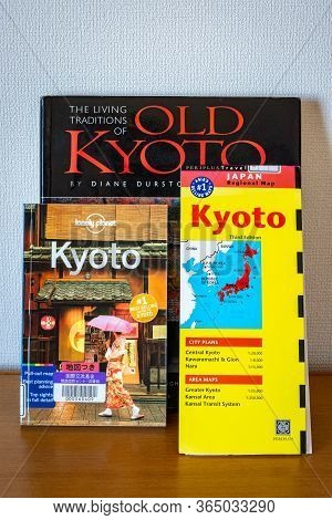 Various Kyoto Travel Guides Spread On The Table. Planning Journey To Kyoto