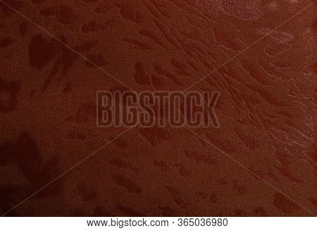 Artificial Red Leather. Faux Leather Texture Close-up. Imitation Suede Spots